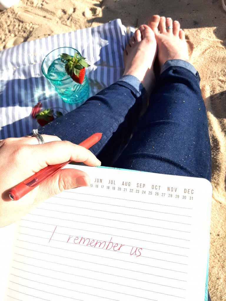 """Jaime Dill's notebook with """"I remember us"""" handwritten in red ink"""